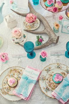 Vintage mix of pretty pink and a pop of turquoise makes this wedding theme uber girly and fairytale. you can place small tea cups with one simple flower randomly on tables. add tea lights and voila :)