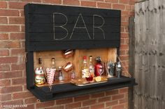 How to make an illuminated drop-down outdoor bar from palletsYou can find Pallet bar and more on our website.How to make an illuminated drop-down outdoor bar from pallets