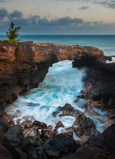 Po'ipu Lava Arch on the island of Kauai, Hawaii. ASPEN CREEK TRAVEL… Don, it's not very large. Go to Shipwreck beach in front of the Grand Hyatt in Poipu and start walking east along the shore. It's at most a 15 minute walk Kauai Vacation, Hawaii Travel, Dream Vacations, Vacation Spots, Beach Travel, Mexico Travel, Spain Travel, Places Around The World, Oh The Places You'll Go