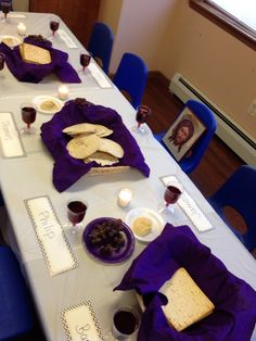 """Last supper"" set up for Sunday school. At each seat, add name of a disciple. Include food like flat or pita bread, grape juice. Have the children say the words of Jesus and break bread with each other. A fun and memorable way to learn about this special event"