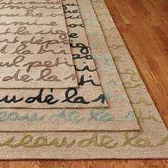 Le Poeme Indoor/Outdoor Rug - this is the rug (8ft square, black lettering) in our kitchen area.  Love it!