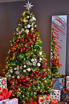 16 Amazing Christmas Tree Decorating Ideas. I love the mirror with Christmas spelled out on it. I would maybe use a chalkboard too.