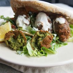 Vegan plant based spinach falafel with tahini dressing and homemade pitta bread