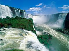 Iguazu Falls, also known as Iguassu or Iguaçu Falls. These waterfalls are situated on the border of Argentina and Brazil. Top Honeymoon Destinations, Travel Destinations, Belize Honeymoon, Dream Vacations, Vacation Spots, Vacation Packages, Vacation Travel, Warung Beach Club, Brazil Argentina
