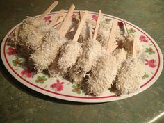 Banana pops. Banana, dipped in honey & water, dipped in coconut.