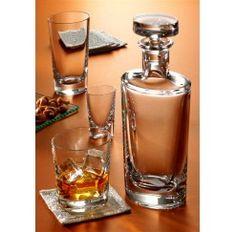 Juego de whisky en cristal Sèvres fabricado artesanalmente con diseño oval y compuesto por: 6 vasos de whisky, 1 botella de whisky y 1 cubo de hielo. Se dice de Sèvres que es el cristal más transparente que jamás ha existido y es que no conviene olvidar que esta firma surge en 1750 para satisfacer directamente al Rey Luis XV de Francia.