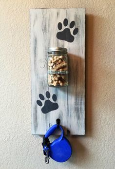Distressed dog treat and leash holder, personalized for the pet(s) of your choice! Perfect to hang on the wall in any room! Makes for a great gift!  PLEASE SPECIFY: Names to be added (if any), color choice, and preferred hook finish.  FEATURES:  1) Dimensions are approximately 24 x 10.5  2) Constructed from 3/4 pine (good quality, very sturdy)  3) Quart-sized, wide-mouth mason jar with lid (treats not included)  4) One leash hook (black or matte nickel). Please let us know which you pref...