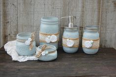 Shabby chic mason jar bathroom jar set. Hand painted in soft grey, lightly distressed, wrapped with burlap, lace, tied with jute and white roses, finished with a protective coating. Metal soap dispens