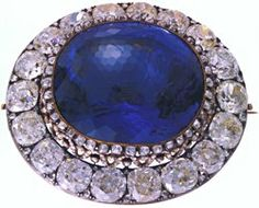 SAPPHIRE BROOCH  RUSSIA, CIRCA 1860  This sapphire was purchased by Alexander II at the London Great Exhibition of 1862 and presented it to his wife, Maria Alexandrovna.  Gold, silver, diamonds (56.60 carats), Ceylon sapphire (260.37 carats) 2 1/8 x 2 3/8 in (6.0 x 5.3 cm)