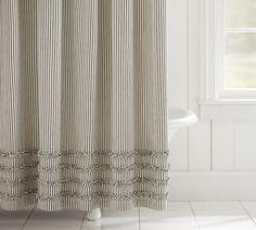 Ruffle, ticking stripe shower curtain. Farmhouse style bathroom.