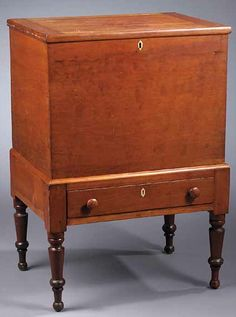 Southern Cherrywood Sugar Chest on Stand in the Sheraton Taste, early 19th c., the top with applied molded edge, dovetailed case, resting in a stand with a single drawer, on tapering turned legs, ending in button feet, ivory or bone diamond-shaped escutcheons top and bottom, height 35 in., width 24 1/2 in., depth 18 in.
