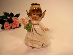 """Vintage Mid Century Price Import April  Girl Angel holding a  bouquet  Pink Flowers .   The Angel is  4 1/2 """" Tall,  and is stamped #706 by VintageQualityFinds on Etsy"""