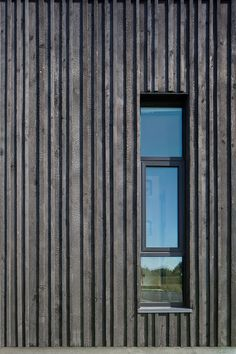 Charred wood vertical siding planks provide depth and shadow to the facade, seen here at this window opening detail a Fire Station 76 by Hennebery Eddy Architects. Larch Cladding, Wooden Cladding, Wooden Facade, House Cladding, Wood Cladding Exterior, Timber Battens, Exterior Stairs, Wall Exterior, Exterior Siding