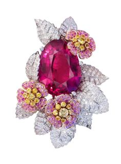 My goodness !! What a combination of ruby, pink and yellow sapphire on diamond leafs !