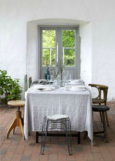 White tablecloth and eclectic chair mix