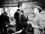 Robert Mitchum, Loretta Young & Bill Holden.