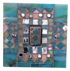 Light switch in blue and silver - mosaic. Hand crafted in Murano and Tiffany stained glass. Size 9 x 9 x 1.5 cm. Please feel free to send me a message on Pinterest for commissions.