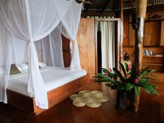 King bed with natural latex and bamboo mattress, luxury bedding and cotton canopy mosquito net.