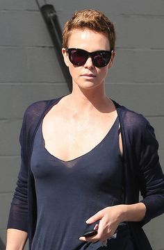 What do you think of Charlize Theron's short hair do? A tad bit gangster perhaps? The only way to offset the attention to your hairstyle? Do it like that.