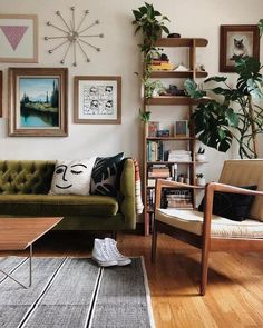 Stunning set up in the living room with mid century furniture, bookcase, green velvet sofa and plants #melaniejadedesign #livingroom