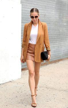 Another polished look for the office. Helena Glazer expertly pairs warm-toned fabrics and accessories to create transitional summer-to-autumn mini skirt outfits. Mini skirt: Mason, Top: Topshop, Shoes: Steve Madden, Purse: Saint Laurent, Sunglasses: Chloe