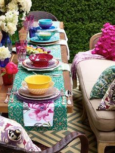 Bohemian beautiful table setting.  Mix and match chargers, plates, bowls, and stemware.  Instead of using a tablecloth, use a runner down each side of the table to serve as on long shared place-mat.  Contrasting napkins finish off each setting.