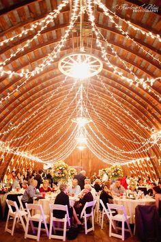 Barn wedding reception with gorgeous lighting decor