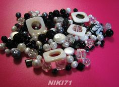 150   Beads - Shades of Black & White       Mon Mar 17 11 pm EST:  http://tophatter.com/auctions/17532?