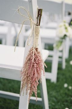 Pink/blush wedding ideas, here's an aisle chair idea we love. Pink Astilbe - Bohemian Barn wedding by Braedon Flynn. Imagine this with lavender, rosemary or mint, tie with your color! Destination Wedding Travel with PJ. #allcouplesallowed #allbridesallowed