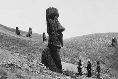 Men observe the giant statues of Easter Island in Polynesia, December 1922. Photograph by J. P. Ault, National Geographic