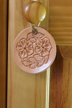 Floral Wall Hanging  Hand Carved Leather by TinasLeatherCrafts. Repin To Remember.