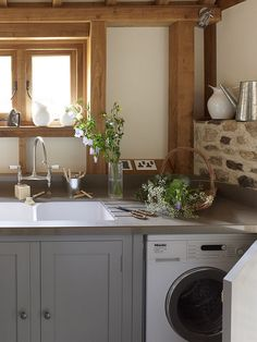 Chalon Utility With Miele Washing Machine by ChalonHandmade, via Flickr        Look at the attention to detail in this room! The sockets mounted on the beam and the gorgeous ironmongery on the windows!