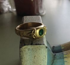 Custom cast ring made for a customer in gold and emerald. #customjewelery #handmadejewelry #rusticjewelry #ancientjewelry #weddingring #wedding #phbeads #goldring#recycledgold#natureinspired#twig#leafring