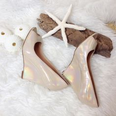 Formal comfortable wedge peep toe heels Formal comfortable wedge peep toe heels. Worn only once to my wedding reception. The perfect bridal shoe for dancing! The height keeps you looking long and lean. Minor scuffs see picture. Color is nude iridescent - so pretty Enzo Angiolini Shoes Wedges