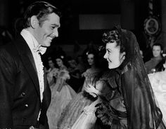 Scarlett and Rhett ready to dance the Virginia Reel in 'Gone With The Wind' (1939)