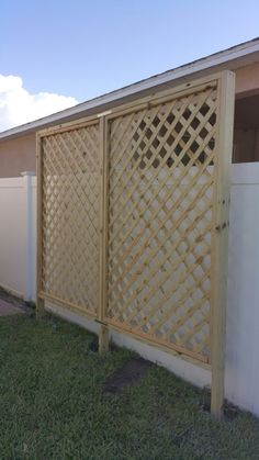DIY lattice privacy screen Built by 2 females multiple trips to Home Depot lattice privacy screen. Built by 2 females & multiple trips to Home Depot Lattice Privacy Fence, Privacy Trellis, Balcony Privacy Screen, Lattice Screen, Privacy Walls, Lattice Wall, Privacy Screens, Privacy Landscaping, Outdoor Privacy