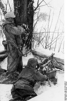 Two German soldiers in position with a MP 43 assault rifle and a MG 42 machine gun - Russia January 1944.