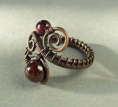 Garnet copper ring by Vera Nasfa, via Flickr