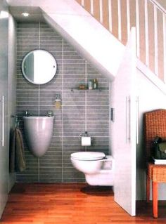 Using Space Beneath the Staircase to Design a Small Bathroom Ideas