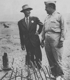 July, 1945. Dr. Robert Oppenheimer (on left) with General Leslie R. Groves (on right) at the Trinity site shortly after the first Atomic Bomb test.