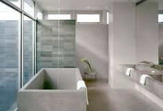 A glass house cut into a rocky slope emphasizes simple geometry and indoor-outdoor relationships. Catskill Mountain House, West Shokan, New York, by Audrey House Bathroom, House Design, Bathroom Concrete Floor, Minimalist Bathroom Design, Bathrooms Remodel, Modern Glass House, Modern Bathrooms Interior, Beach House Bathroom, Modern Bathroom Decor