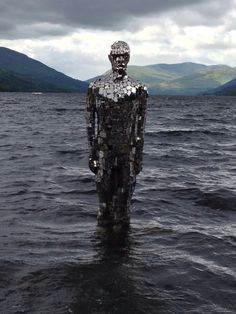 Mirrored figure at Loch Earn by Rob Mulholland