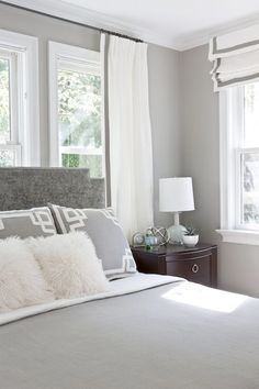 Gray Bedroom Features Gray Walls Framing Gray Velvet Headboard With Silver  Nailhead Trim Accented With White And Gray Bedding And White And Gray Greek  Key ...
