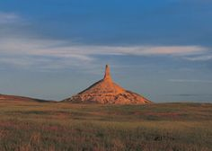 Designated  the Chimney Rock National Historic Site, Bayard in Morrill County, NE, Located approximately 4mi south of present-day Bayard in Millard County, at the south edge of the  North Platte River Valley, is a natural geologic formation, rises 325' from a conical base, composed  of layers of volcanic ash & brule clay dating back to the Oligocene Age (34million-23 million years ago), towers 480' above the North Platte River  Valley.
