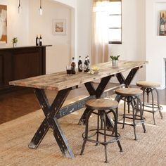 Handcrafted of reclaimed wood, this rugged and beautiful gathering table is highly functional with resounding style.