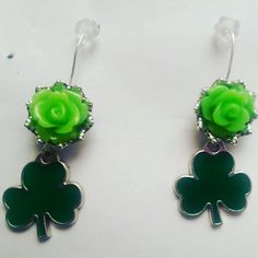 Green flower shamrock silver earrings Designed these using light green ceramic flowers glued to silver filigree added green shamrock and hand made backings By Earth And Sea Jewelry Jewelry Earrings