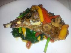Braised Lamb medallion on a bed of Sauteed Spinach with Roasted Peppers...