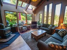This rustic 3 bedroom Tofino rental is nestled at the back of a large 2 acre lot and features an open concept living room, post and beam construction. Vacation Apartments, Cabin Rentals, Ideal Home, Condo, Patio, Rustic, Bedroom, Outdoor Decor, House