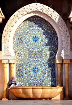 Dipped in Turquoise and Azure Islamic Arabesque Architecture.