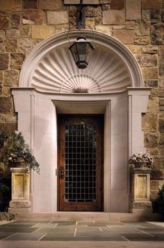 Door in shell headed niche surround.